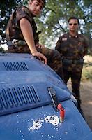 """- Calabria patrol in Aspromonte by NAPS special force (State Police Anti-kidnapping Unit) at San Luca village in search of kidnapped Paolo Canale; seizure of ammunition for """"shotgun"""": buckshots and salt (July 1992)<br /> <br /> - Calabria, perlustrazione in Aspromonte del reparto speciale NAPS (Nucleo Antisequestri Polizia di Stato) nei pressi del paese di S.Luca in cerca del rapito Paolo Canale; sequestro di munizioni per """"lupara"""": pallettoni e sale (luglio 1992)"""