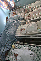 """A Palestinian woman gave birth to four children at Shifa Hospital in Gaza after 16 years of marriage without children, 3 girls and boy September 19, 2007.""""photo by Fady Adwan"""""""