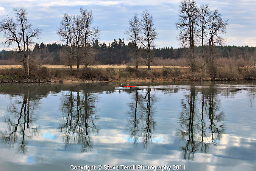 Kayakers on Lewis River seperating Clark and Cowlitz County, Washington