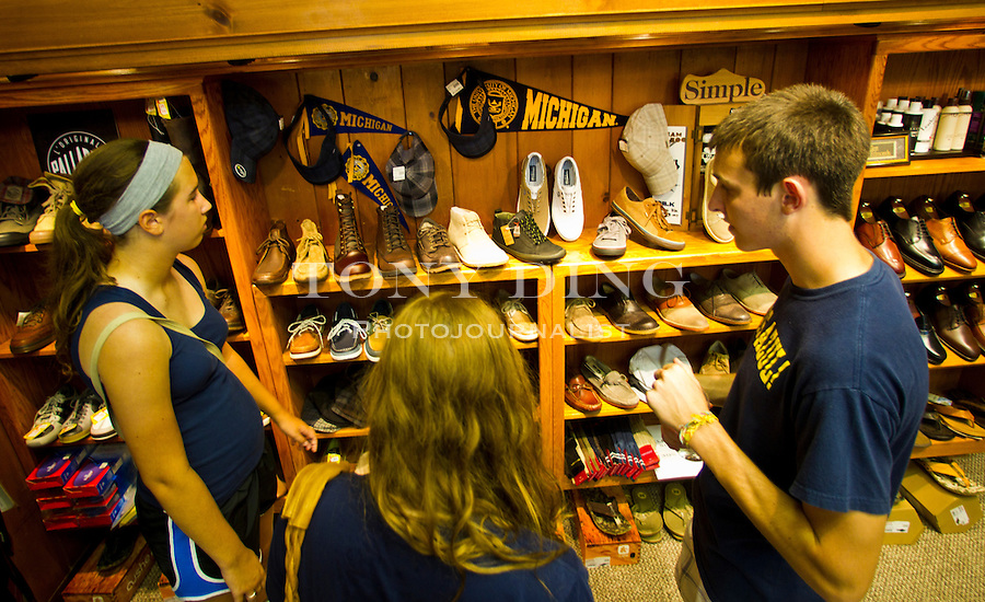 Michigan students browse the shoe selection at Van Boven Shoes in Nickels Arcade, Friday, Sept. 2, 2011 in Ann Arbor, Mich. (Tony Ding for The New York Times)
