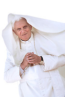 .Pope Benedict XVI waves as he leaves his weekly general audience on October 21, 2009 at St Peter's square at The Vatican... .