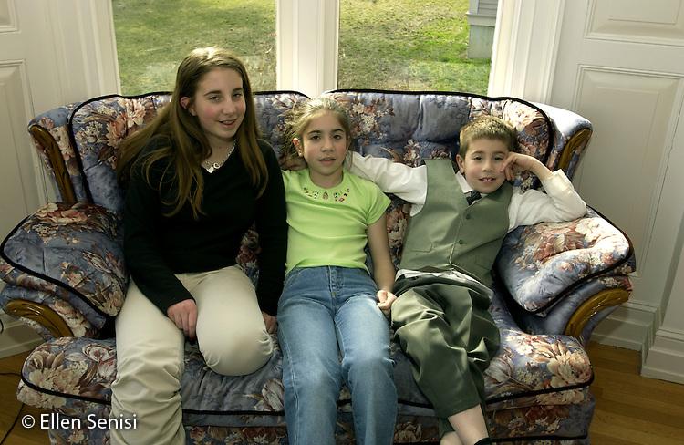 MR / Little Falls, New York .Siblings (14,11,9) at home..Bab4 Bab5 Bab6.© Ellen B. Senisi