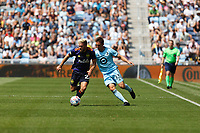 Ethan Finlay #13 of Minnesota United FC and Kelyn Rowe #22 of the Seattle Sounders FC battle for the ball