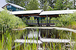 Visitor Center building with pond, cattails and walkway, Nisqually National Wildlife Refuge, Washington State.