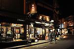 A Japanese couple in Yukata walk down a street of Kinosaki Onsen, hot spring village, in Hyogo.<br /> <br /> Un couple japonais de Yukata descend une rue de Kinosaki Onsen, village des sources thermales, à Hyogo.