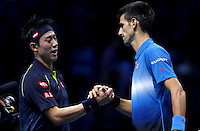 Kei Nishikori of Japan shakes hands with Novak Djokovic of Serbia at the ATP World Tour Finals, The O2, London, 2015