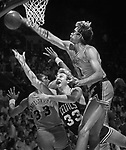 NBA Finals in which the Los Angeles Lakers put down Boston's Larry Bird in a last ditch flailing attempt to get to the rim. copyright, Orange County Register/Jim Mendenhall old bw portfolio