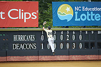 Wake Forest Demon Deacons left fielder Chris Lanzilli (24) climbs the wall to try and catch a home run hit by the Miami Hurricanes at David F. Couch Ballpark on May 11, 2019 in  Winston-Salem, North Carolina. The Hurricanes defeated the Demon Deacons 8-4. (Brian Westerholt/Four Seam Images)