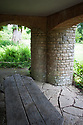 Columns of Bargate stone support the early 20th-century extension and pergola, Vann House and Garden, Surrey, mid June.