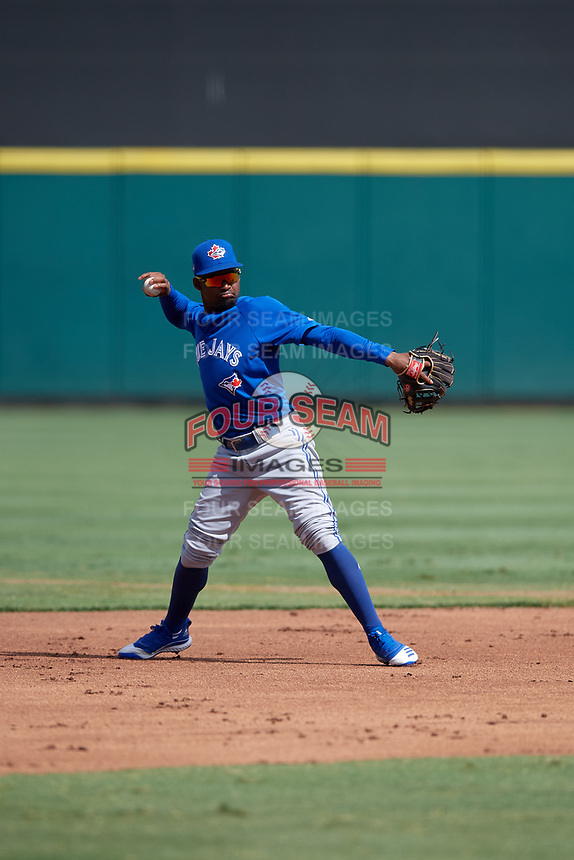 Toronto Blue Jays shortstop Orelvis Martinez (15) throws to first base during a Florida Instructional League game against the Detroit Tigers on October 19, 2020 at Joker Marchant Stadium in Lakeland, Florida.  (Mike Janes/Four Seam Images)