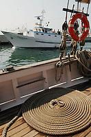 - fishing boats leave the port..- pescherecci lasciano il porto