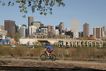 Man cycling at Confluence Park, Denver, Colorado, .  John offers private photo tours in Denver, Boulder and throughout Colorado. Year-round.