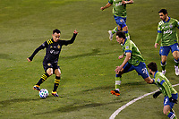 COLUMBUS, OH - DECEMBER 12: Lucas Zelarayan #10 of Columbus Crew battles for the ball against Shane O'Neill #27 of Seattle Sounders FC during a game between Seattle Sounders FC and Columbus Crew at MAPFRE Stadium on December 12, 2020 in Columbus, Ohio.