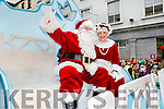 Santa and Mrs Claus arrive at the CH Chemist's Santa Parade on Saturday.