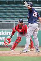 Boston Red Sox Alberto Schmidt (29) checks the runner as Chris Paul (26) signals to stay during an Instructional League game against the Minnesota Twins on September 23, 2016 at JetBlue Park at Fenway South in Fort Myers, Florida.  (Mike Janes/Four Seam Images)