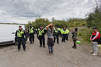 Pictured: Police surround the sound equipment which they confiscated. Monday 31 August 2020<br /> Re: Around 70 South Wales Police officers executed a dispersal order at the site of an illegal rave party, where they confiscated sound gear used by the organisers in woods near the village of Banwen, in south Wales, UK.