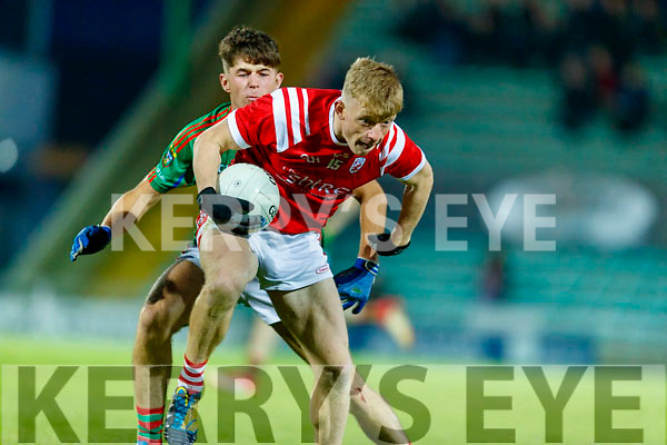 Evan Cronin, East Kerry and David Mangan, Mid Kerry during the Kerry County Senior Football Championship Final match between East Kerry and Mid Kerry at Austin Stack Park in Tralee on Saturday night.