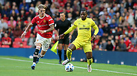 Tariqe Fosu of Brentford in possession as Manchester United's Brandon Williams looks on during Manchester United vs Brentford, Friendly Match Football at Old Trafford on 28th July 2021