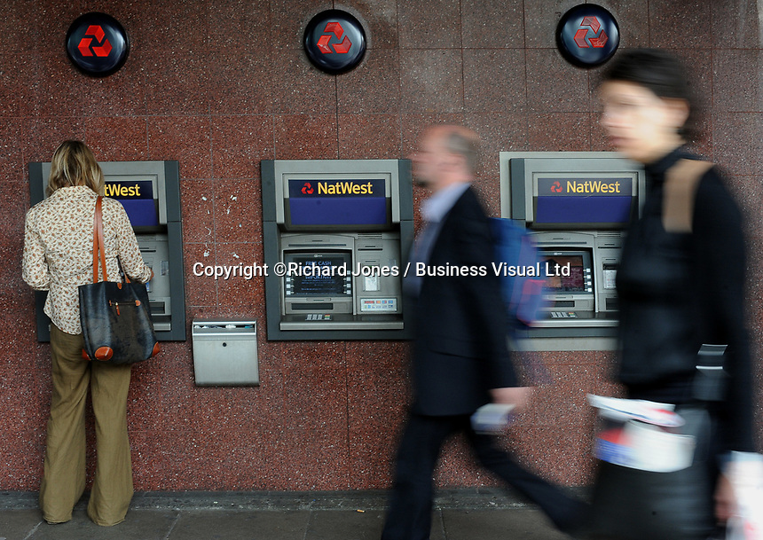People pass the  NatWest bank in London.  The NatWest and other lenders anticipate a surge in lending as the Government helps first time buyers get on the mortgage ladder. 14-Oct-2013