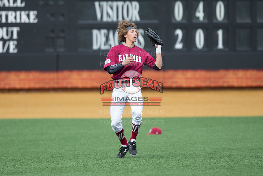 Harvard Crimson left fielder Trent Bryan (23) catches a fly ball during the game against the Wake Forest Demon Deacons at David F. Couch Ballpark on March 5, 2016 in Winston-Salem, North Carolina.  The Crimson defeated the Demon Deacons 6-3.  (Brian Westerholt/Four Seam Images)