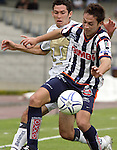 Mexico (26.02.2006) UNAM Pumas defender Israel Castro(L) fights for the ball with Monterrey Rayados midfielder Diego Ordaz during their soccer match at the Mexico City's University Stadium, February 26, 2006. UNAM tied 0-0 to Monterrey. © Photo by Javier Rodriguez
