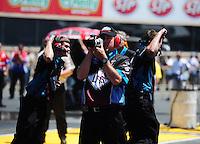 Jul. 31, 2011; Sonoma, CA, USA; Crew members for NHRA funny car driver Tim Wilkerson celebrate a win during the Fram Autolite Nationals at Infineon Raceway. Mandatory Credit: Mark J. Rebilas-