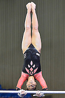 Nebraska's Jennie Laeng competes on the uneven bars during the semifinals of the NCAA women's gymnastics championships, Friday, April 17, 2015 in Fort Worth, Tex.(Mo Khursheed/TFV Media via AP Images)