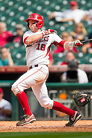 Tim Carver #18 of the Arkansas Razorbacks follows through on his swing against the Texas Tech Red Raiders at Minute Maid Park on March 2, 2012 in Houston, Texas.  The Razorbacks defeated the Red Raiders 3-1. (Brian Westerholt/Four Seam Images)