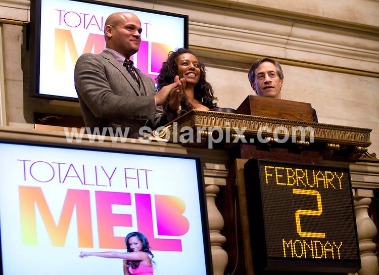 """**ALL ROUND PICTURES FROM SOLARPIX.COM**.**SYNDICATION RIGHTS FOR UK, AUSTRALIA, DENMARK, PORTUGAL, S. AFRICA, SPAIN & DUBAI (U.A.E) ONLY**.Melanie Brown Rings the Closing Bell at the New York Stock Exchange. Mel B is currently promoting her """"Totally Fit"""" fitness program and newly released DVD. New York Stock Exchange, New York City, NY, USA...This pic: Stephen Belafonte and Melanie Brown..JOB REF: 8389 PHZ (Mayer)  DATE: 02_02_2009 .**MUST CREDIT SOLARPIX.COM OR DOUBLE FEE WILL BE CHARGED* *ONLINE USAGE FEE £50.00 PER PICTURE - NOTIFICATION OF USAGE TO PHOTO@SOLARPIX.COM*"""