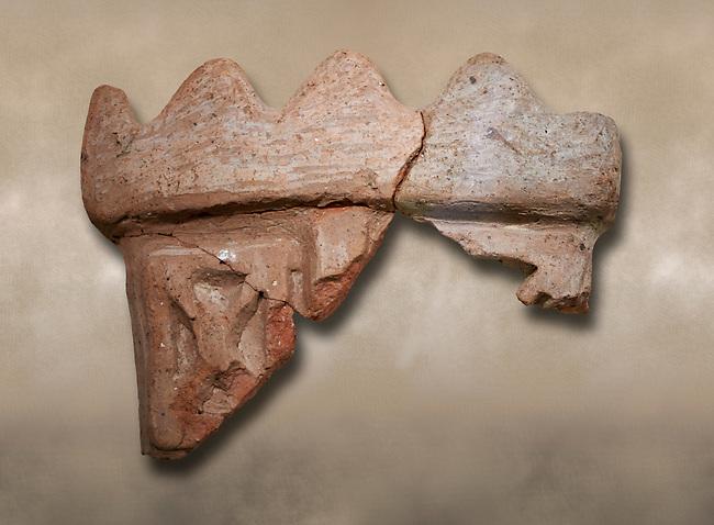 Hittite terra cotta fragmants of a defenive wall tower shaped vessel . Hittite Period, 1600 - 1200 BC.  Hattusa Boğazkale. Çorum Archaeological Museum, Corum, Turkey. Against a warm art bacground.