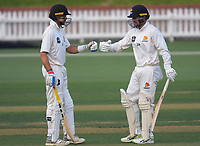 Jacob Bhula and Tom Blundell during day two of the Plunket Shield men's cricket match between Wellington Firebirds and Northern Districts at the Basin Reserve in Wellington, New Zealand on Sunday, 28 March 2021. Photo: Dave Lintott / lintottphoto.co.nz