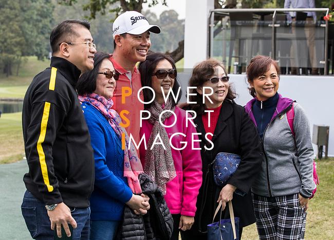Ashun Wu of China takes photos with the fans during the day three of UBS Hong Kong Open 2017 at the Hong Kong Golf Club on 25 November 2017, in Hong Kong, Hong Kong. Photo by Yu Chun Christopher Wong / Power Sport Images