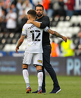 11th September 2021; Swansea.com Stadium, Swansea, Wales; EFL Championship football, Swansea versus Hull City; Russel Martin manager of Swansea City speaks with Jamie Paterson after the match