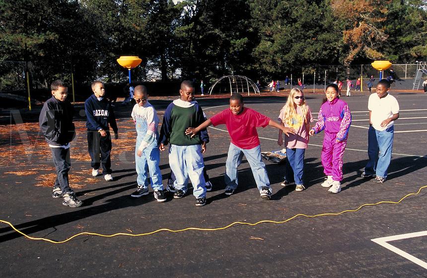 Recess at Carl Munck Elementary School. Playground activities. Oakland, California.
