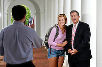 Politics professor Larry Sabato takes a photograph with a fan at the University of Virginia in Charlottesville, Va. Photo/Andrew Shurtleff