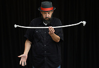 George Reader, a magician from Bella Vista, makes a rope appear to become frozen in midair Wednesday, July 21, 2021, during a performance at the Prairie Grove Public Library. The show was the finale for the library's summer reading program. Visit nwaonline.com/210722Daily/ for today's photo gallery.<br /> (NWA Democrat-Gazette/Andy Shupe)