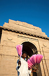June 21 2012, New Delhi, India:  A man sells fairy floss under the India Gate. India Gate is the national monument of India. Situated in the heart of New Delhi, India Gate was designed by Sir Edwin Lutyens. Originally known as All India War Memorial, it is a prominent landmark in Delhi and commemorates the 90,000 soldiers of the British Indian Army who lost their lives while fighting for the British Indian Empire, or more correctly the British Empire in India British Raj in World War I and the Third Anglo-Afghan War. It is composed of red sand stone and granite.        Picture by Graham Crouch/Holland Herald