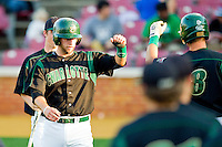 Ross Steedley #40 of the Charlotte 49ers fist bumps teammate Shane Basen #8 after scoring a run against the Wake Forest Demon Deacons at Gene Hooks Field on March 22, 2011 in Winston-Salem, North Carolina.   Photo by Brian Westerholt / Four Seam Images
