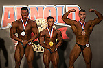 (L-R) Benjamin Broughton of Singapore, Misha Al Juabou of Saudi Arabia and Shiparev Yevgenig of Kazakhstan flex their muscles in the Arnold Classic Mens Bodybuilding during the Arnold Classic Asia 2016 Multi-Sport Festival on 20 August 2016 at the AsiaWorld-Expo, Hong Kong. Photo by Marcio Machado / Power Sport Images