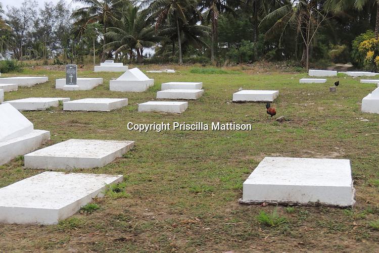 Rarotonga, Cook Islands - September 21, 2012:  Horizontal white slabs in a cemetery.
