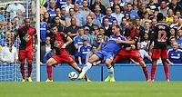 Pictured: Branislav Ivanovic of Chelsea (C) is held back by Jordie Amat (2nd L) and Gylfi Sigurdsson (4th L) of Swansea. Saturday 13 September 2014<br /> Re: Premier League Chelsea FC v Swansea City FC at Stamford Bridge, London, UK.