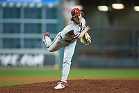 Arkansas Razorbacks relief pitcher Jacob Burton (21) follows through on his delivery against the Texas Longhorns in game six of the 2020 Shriners Hospitals for Children College Classic at Minute Maid Park on February 28, 2020 in Houston, Texas. The Longhorns defeated the Razorbacks 8-7. (Brian Westerholt/Four Seam Images)