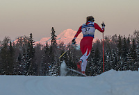 Morning light illuminates Denali as Ryan Terry of Bridger Ski Foundation competes in the Women's 20k Classic during the 2018 U.S. National Cross Country Ski Championships at Kincaid Park in Anchorage.