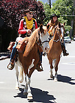Bob Moore and Deby O'Gorman ride onto the Capitol grounds during the annual Pony Express Re-ride through Carson City, Nev., on Thursday, June 12, 2014. Moore, 90, has ridden in every re-ride since the commemorative rides began in 1978. (Las Vegas Review-Journal/Cathleen Allison)