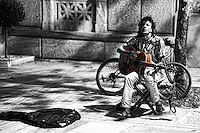 A musician playing guitar in the street of Athens, Greece