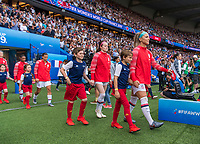 PARIS,  - JUNE 28: Rose Lavelle #16 and Julie Ertz #8 enter the field during a game between France and USWNT at Parc des Princes on June 28, 2019 in Paris, France.
