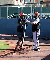 Marco Luciano (left), hitting coach Travis Ishikawa (right) - San Francisco Giants 2019 spring training (Bill Mitchell)