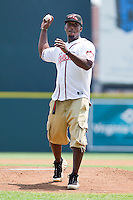Former Virginia Tech Hokie quarterback Tyrod Taylor throws out the first pitch prior to the Eastern League between the Harrisburg Senators and the Richmond Flying Squirrels at The Diamond on July 22, 2011 in Richmond, Virginia.  The Squirrels defeated the Senators 5-1.   (Brian Westerholt / Four Seam Images)