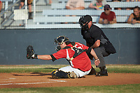 Lake Norman Copperheads catcher Damon Massey (15) (West Virginia St) frames a pitch as home plate umpire Britt Kennerly looks on during the game against the Mooresville Spinners at Moor Park on July 6, 2020 in Mooresville, NC.  The Spinners defeated the Copperheads 3-2. (Brian Westerholt/Four Seam Images)