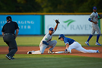 Eric Cole (2) of the Burlington Royals steals second base ahead of the tag from Yoel Romero (15) of the Kingsport Mets as umpire Zachary Robbins looks on at Burlington Athletic Stadium on July 27, 2018 in Burlington, North Carolina. The Mets defeated the Royals 8-0.  (Brian Westerholt/Four Seam Images)